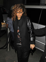 Rihanna went clubbing in a black wool coat with leather contrast sleeves.