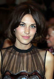 Alexa Chung kept with her signature style and wore her brunette bob in a straight center part hairstyle.