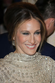 Sarah Jessica Parker attended the 2011 Met Gala wearing rose-cut diamond cluster pendant earrings.