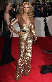 Iman completed her metallic sequin jumpsuit with a 1940's citrine and gold ring.