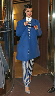 Rihanna gave her winter wardrobe a bold burst of color with a bright blue pea coat from Raf Simons' fall 2012 collection.