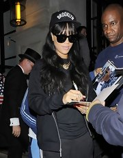 Rihanna rocked a Brooklyn baseball cap while signing autographs on her way to the gym.