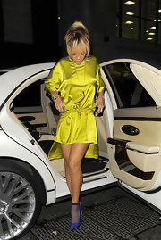 Rihanna wore this shiny silk chartreuse dress out for a night on the town.
