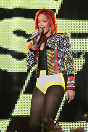 Rihanna paired her tribal inspired cropped jacket with an arm full of decorative bangle bracelets. The songstress rocked out on stage in Time Square while preforming her latest hits for MTV.