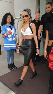 Rihanna showed off her toned tummy with this black leather pencil skirt that featured unique suspender detailing.