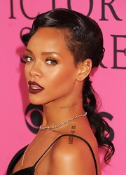 Rihanna finished off her sexy look with a dark burgundy lip color.