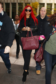 Rihanna showed off a leather embossed tote bag while leaving her hotel in New York.