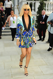 Rihanna heated up London wearing this--only this--abstract print blazer.