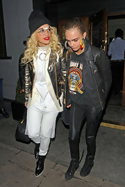 Cara Delevingne stepped out at the Groucho Nightclub in a pair of Nikes.