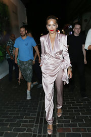 Rita Ora kept it classy in a pale pink, silky jumpsuit that featured pleated detailing, notch lapels, and a side bow.
