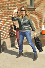 Rita Wilson looked sleek and cool in a green leather jacket, which featured gold and silver studded designs on the shoulders.