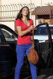 Hope Solo finished off her color-block style with a woven cognac tote.