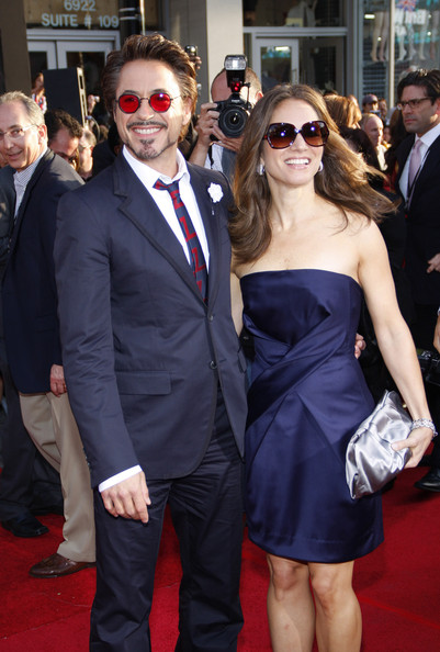 Robert topped off this stylish ensemble with round sunglasses featuring red lenses.