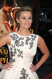 Reese was all smiles on the red carpet at the premiere of 'Water for Elephants.' The actress wore an antique diamond cluster ring which was an exquisite accent to Witherspoon's beautiful attire.