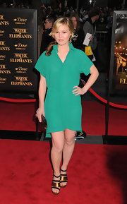 Julia Stiles teamed her Kelly green frock with gold and black sandals with thick metallic straps.