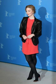 Holliday Grainger went both girly and tough as she combined a leather jacket and a classic cut dress.