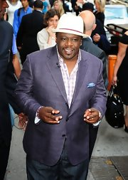 Cedric the Entertainer sported an eye-catching ensemble on 'Good Morning America': a purple plaid blazer over a white and purple plaid shirt.