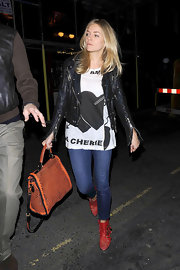Sienna looks biker chic in a zippered leather jacket while out at Box nightclub.
