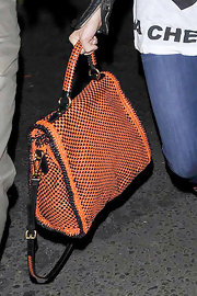 Sienna Miller carried her leather Mandarino and Nero Madras bag by Prada whilst visiting Box.