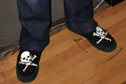 Ozzy wears skull and crossbones on his comfy slippers.