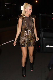 Karissa Shannon paired her warrior princess look with black cutout ankle boots.