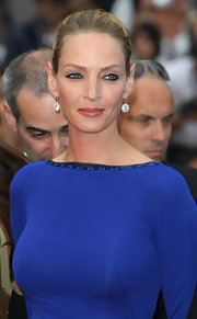 Uma Thurman wowed at the Cannes closing ceremony in classic diamond drop earrings.