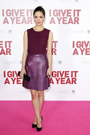 Rose looked plum perfect in this rich purple dress with a leather skirt at the Sydney premiere of 'I Give it One Year.'