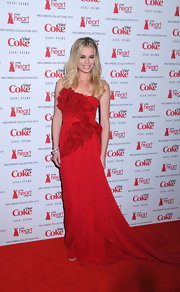 Rebecca Romijn donned a mousseline red gown to the Heart Truth's red dress collection fashion show.