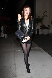 While hitting the trendy nightclub Trousdale in Hollywood, Rose McGowan showed off her coveted quilted leather bag.