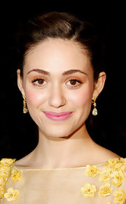 Emmy Rossum attended the 9th Annual Global Green USA pre-Oscar party wearing a pair of yellow pear and marquise-cut diamond drop earrings set in yellow gold.