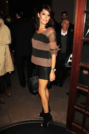 Danielle Bux kept it casual in a striped knit top at a party in London.