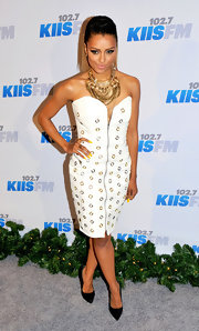 Kat brought her unique style to Jingle Ball in this white zippered dress.