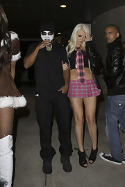 Karissa Shannon attended Paris Hilton's Halloween party wearing a plaid tie and a matching mini skirt.