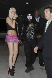 Karissa Shannon wore a dangerously short plaid skirt during Paris Hilton's Halloween party.