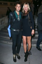 Kate Moss wore slouchy mid-calf high heel boots with her body-hugging LBD.
