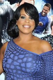 Niecy styled her locks in a low side bun with side swept bangs. Oh-so elegant!