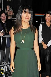 Salma Hayek took her look to the wild side with this animal head and tooth pendant necklace.