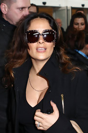 Salma Hayek glammed it up at the airport in oversize tortoiseshell shades that gave her a modernized Jackie O flair.