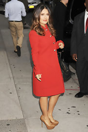 Salma Hayek was '60s chic in a streamlined red coat a peter pan collar and brass buttons.
