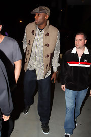 Lamar Odom topped off his eclectic ensemble with a patterned newsboy cap while clubbing with friends.