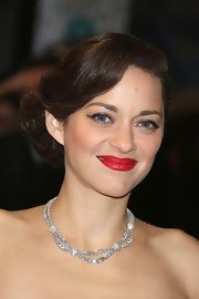 Flippant bangs and a soft bundle of curls defined Marion's updo at the 2013 BAFTAs.