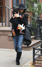 Sandra Bullock kept comfy in black sheepskin boots.