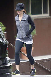 Sandra kept her look athletic and casual with a pair of black workout leggings.