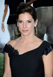At the highly anticipated premiere of The Blindside, Sandra showed off this sleek and stylish up-do, which she accompanied with a pair of gold hoop earrings.