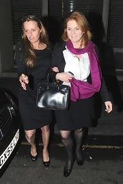 Sarah Ferguson created a twist on her classic button down shirt and skirt ensemble by adding a purple scarf.