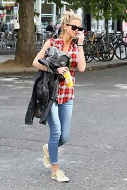 Sarah Harding spent her day out and about shimmering in glamorous gold sneaks.