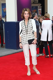 Natasha chose cream-colored capri pants for a classic and sophisticated red carpet look.