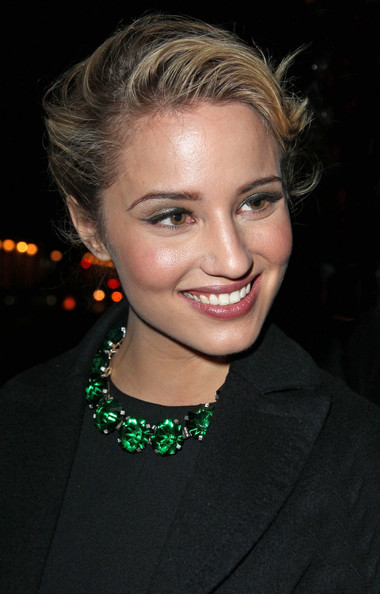 Dianna Agron attended the Louis Vuitton fall 2012 fashion show wearing her hair in a chic bobby-pinned updo.