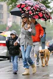 Sarah stayed dry under a colorful floral umbrella. This fashionista is even on trend in the rain.
