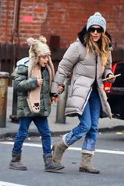 Sarah Jessica Parker bundled up in NYC wearing this long puffy jacket with a fur-trimmed hood.